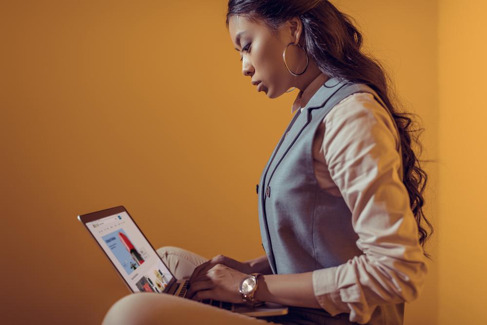 Businesswoman using laptop with ebay website
